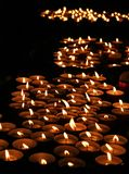 Many lit candles in the Church Stock Photo