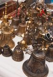 Many little bells on the table of the stall stock images