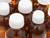 Many little closed amber glass pharmacy bottles Stock Photography