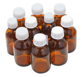 Many little closed amber glass pharmacy bottles Royalty Free Stock Images