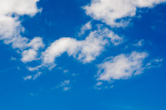 Many little fluffy clouds in blue sky in summer Stock Image
