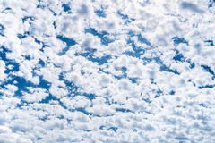 Many little white clouds and blue sky on sunny day Stock Images