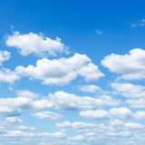 Many little white clouds in summer blue sky Stock Image