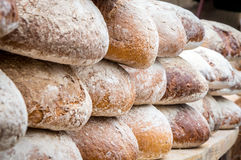 Many loaves of bread in a bakery. Many delicious loafs of bread in a bakery royalty free stock image
