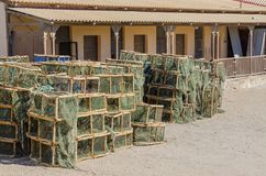 Many lobster or crayfish traps stacked in front of old building, Luderitz, Namibia, Southern Africa.  Royalty Free Stock Photos