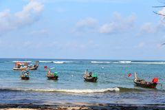 Many local fisherman boat on coast line in sunshine day. Blue sky ocean Royalty Free Stock Photo