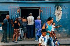 Many locals standing in line in Havana city, Cuba. Many locals standing in line in front of a popular store in Havana city, Cuba stock photo