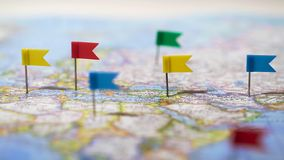 Many locations marked with pins on world map, global communication network. Stock photo stock photo