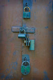 Many locks and bolts on the gate. Royalty Free Stock Photos