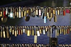 Many locks without keys hang on a bridge in Ljubljana, Slovenia. Locks left by people in love, a symbol of eternal love.  stock photos