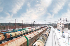Many long freight trains at railway station at winter day Royalty Free Stock Photography