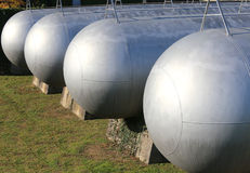 Many long gas pressure vessels for the storage of flammable natu. Many long giant gas pressure vessels for the storage of flammable natural gas in the fuel Stock Images