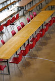 Many long table with red chairs Royalty Free Stock Photography