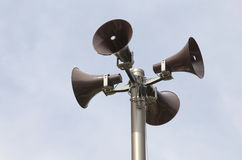 Many loudspeakers against cloudy blue sky Stock Photography