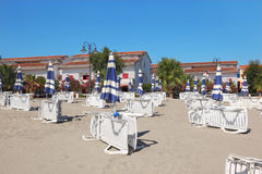 Many lounges and umbrellas on beach Royalty Free Stock Image