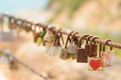 Many Love locks on fence. Symbol of eternal love, friendship and romance Stock Photos