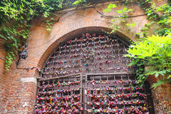 Many love locks on the gates of the Juliet house in Verona Royalty Free Stock Photo
