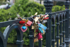 Many love locks are on the modern bridge. In Amsterdam the Netherlands, Europe Stock Photography