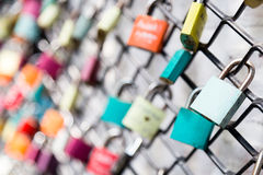 Many love padlocks on fence concept with selective focus on a blank lock at foreground Royalty Free Stock Photos