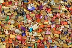 Many love padlocks locked on iron chain at landmark, tourists place - padlocks love sign and romance concept,. Many love padlocks locked on iron chain at royalty free stock photo