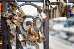 Padlocks love sign, romance and togetherness concept. Many love padlocks locked on rusty iron gate at Old Bridge, in Florence Royalty Free Stock Images
