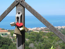 Many love padlocks, one heart shaped, closeup on a blurred background in summer Stock Photography