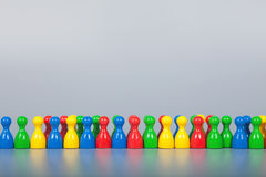 Many Ludo Figures in a row Stock Photo