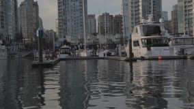 Many luxury yachts at the Yaletown Marina. VANCOUVER,CANADA - CIRCA December 2014 :Many luxury yachts at the Yaletown Marina stock video footage