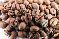 Many macro coffe beans closeup on coffee background. Stock Photo