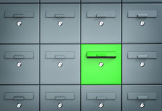 Many mailboxes one of which is green Royalty Free Stock Photo