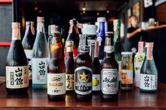 Many major and minor brands of Japanese liquors are including beer, sake, spirits and umeshu in Japanese restaurant.  stock photo