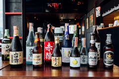 Many major and minor brands of Japanese liquors are including beer, sake, spirits and umeshu in Japanese restaurant.  stock image