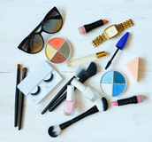 Many makeup products on white wooden background Royalty Free Stock Photos