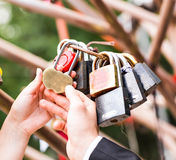 Many marriage love symbol padlocks chained on. Bridge stock photos