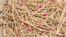 Many matches with brown and rose match heads scattering on rows. Many matches with brown and rose match heads scattering on three rows of matches Stock Photos