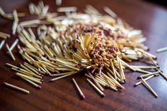 Many matches lying on the table with blur background. Closeup. Stock Photography