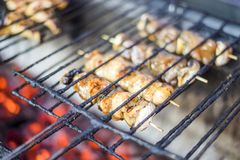 Many meat skewers barbequed on charcoal. In the restaurant stock images