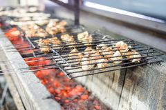 Many meat skewers barbequed on charcoal. In the restaurant royalty free stock photos