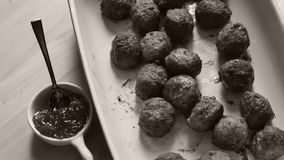 Meatballs for dinner. Many meatballs and some jam in a plate, Swedish dish