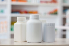 Many medicine bottle with blur shelves of drug in the pharmacy Stock Images