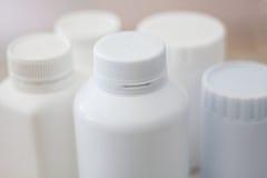 Many medicine bottle with blur shelves of drug Stock Images