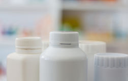 Many medicine bottle with blur shelves of drug Royalty Free Stock Images