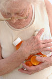 So Many Medicines. Mature woman in her eighties clasping sooo many prescription bottles royalty free stock photos