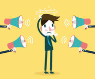 Many megaphone Shouting at Businessman. Concept of Stress at work. Royalty Free Stock Image