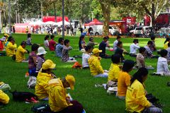 Falun Gong Members Meditating in Hyde Park, Sydney, Australia. Many members of Falun Gong, a modern Chinese spiritual practice that combines meditation and Stock Photo