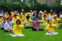 Falun Gong Members Meditating in Hyde Park, Sydney, Australia. Many members of Falun Gong, a modern Chinese spiritual practice that combines meditation and Stock Image