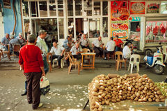 Many men drinking tea and talking in tea garden near the vegetable market of Sirince village Royalty Free Stock Images