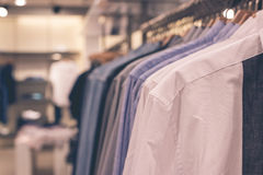 Many men shirts hanging on a rack in the shopping mall, Bali island, Indonesia. Stock Photo