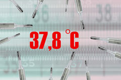 Many mercury thermometers and bodys temperature. 37,8 C in red Stock Photo