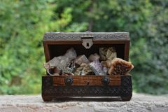 Many minerals quartz and crystal stones in wooden box Royalty Free Stock Photo